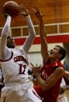 E.C. Central's Hyron Edwards shoots over Munster's Luke Wuchenich
