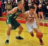 Portage's Michael Lattanzi tries to drive the baseline on Valparaiso's John Mosser