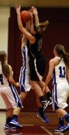 Lake Central's Jessica DelBovo defends against Lowell's Carley Austgen