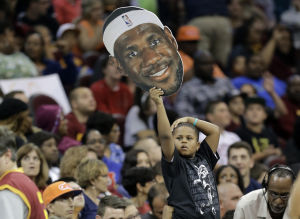 "LeBron warmly welcomed ""home"" by Cleveland fans"