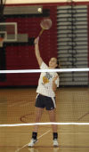 T.F. South's Cassie Breshock practices for the Illinois State Badminton tournament.