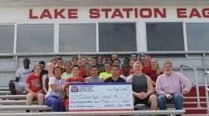 Union carpenters donate to high school track team