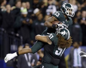 No. 10 Michigan St. shocks No. 2 Ohio St. for Big Ten Championship