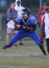 Lake Central's Antwan Davis looks for some running room