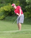 Portage's Nick Lewis chips onto the green on No. 2 at Forest Park during Friday's Valparaiso Sectional.