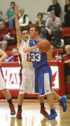 Boone Grove's Sam Eleftheri is guarded by Washington Township's Alex Lowther on Thursday at the Porter County Conference tourney.