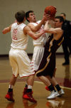 Munster's Mike Hayes and Chesterton's Cory Rusboldt battle for possession of the basketball Tuesday.