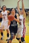Covenant Christian's Rachel Schurman tries to drive by Washington Township's Donnae Lipinski on Tuesday night in the opening game of the Class A Kouts Sectional.