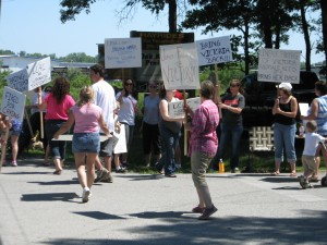 Protesters at bike ride charity event say animal center's firing of employee 'a disgrace'