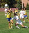 Highland's Katherine Smailis heads the ball