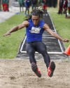 Bloom Township's Malik Jenkins competes in the long jump during Wednesday's Southland Athletic Conference track meet.
