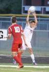 Chesterton's Jameson Sensibaugh completes a throw-in against Crown Point on Wednesday.