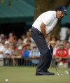 Phil Mickelson reacts after missing a putt on the 18th