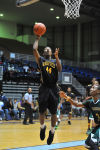 Roosevelt's Omar King drives in for layup Saturday night at the Genesis Center.