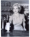 Actress Lana Turner Serving Up Soda Fountain Drink