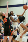 Merrillville senior guard Audrianna Downs shoots against LaPorte senior center Kelsey Gushrowski during Saturday's Class 4A Hobart Sectional title game.