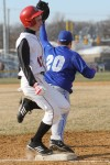 Munster senior Adam Larimer sprints past first base