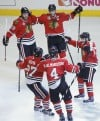 The Blackhawks celebrate a first-period goal against Boston during Game 5 of the Stanley Cup Final on Saturday.