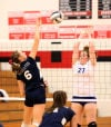 South Central's Riley Popplewell tries to hit over the block attempt of Boone Grove's Katie Brown during Thursday's opening round of the PCC tournament.