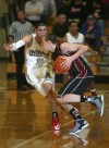 Munster's Craig Dedelow guards Lowell's Eric Zukauskas