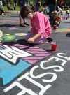 Kids paint the Crete Library parking lot