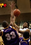 Lew Wallace's Thomas Salliee shoots over Gavit's Jeremy Irons during a semifinal play Friday at the Class 3A Hammond Sectional.