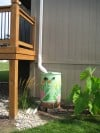 Go green with rain barrels in your garden
