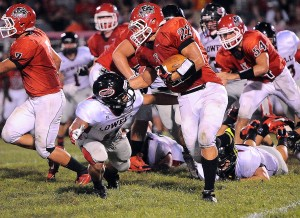 Red Devils topple Kougars for first win of season