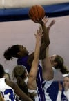 Merrillville's Jaz Talley shoots over Lake Central's Lindsay Kusbel on Friday.