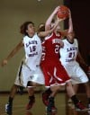 E.C. Central's Alicia Jackson defends against Munster's Jordan Cole on Wednesday.