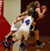 Lowell's Katlyn Bobos steals the ball and goes through Lake Central's Megan Krol