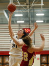 Bishop Noll's Elena Sobilo lays up a shot around River Forest's Colleen Cary during the GSSC tourney championship.