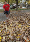 Russell Brach blows some leaves