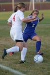 Crown Point's Maddie McConnell, lleft, and Lake Central's Hannah Triveline battle for possession of the ball Tuesday night.