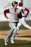 Andrean's Joey Plesac scores in the first inning