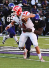 Merrillville's Cantrell Henderson tackles Crown Point quarterback Artie Equihua