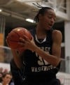 Washington's Victoria Bradley grabs a rebound