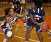 West Side's Antoinette Taylor guards E.C. Central's Mariah Lewis
