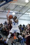 Lake Central senior Tye Wilburn takes a shot during Friday night's Duneland Conference game against Chesterton.