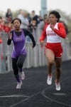 T.F. North runner Imani Cobbs attempts to pass