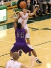 Valparaiso's Tyler Doane passes over Merrillville's Jalen Wilbert to fellow Viking John Mosser on Friday.