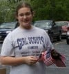 Teen salutes the flag to earn Girl Scout Gold Award