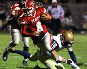 T.F. South quarterback Cody Petrich runs the ball against Lemont