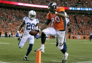 Broncos hold off Colts to win season opener