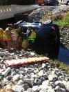 Former Portage officer helps save woman after crash