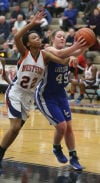 West Side's Mylesha Crisler and Lake Central's Lindsay Kusbel battle for a rebound during Friday's semifinals of the Class 4A Lowell Sectional.