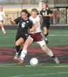 Portage's Kristen Ashby, left, locks up with Chesterton's Rosie Biehl
