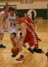 Crown Point's Tom Bardeson tries to drive past Valparaiso's Brody Wilson