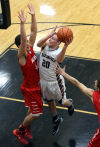 Lowell's Eric Zukauskas shoots over Munster's Nikola Mandic at Lowell.