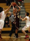 Chesterton's Jacob Wasielewski ties to pass around Munster's Pat McCarthy on Tuesday night.